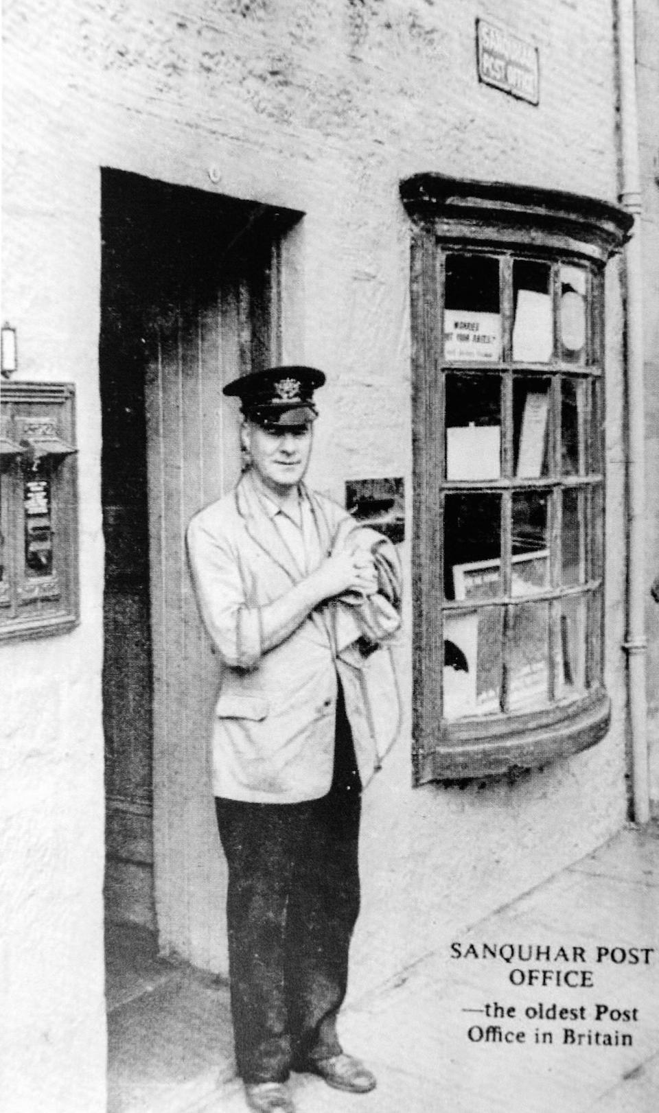 Postman Bob Morrison at Sanquhar Post Office in Dumfries and Galloway (Picture: SWNS)