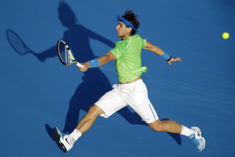 """FILE - This Dec. 31, 2011 file photo shows Spain's Rafael Nadal returning the ball to Roger Federer of Switzerland during the final day of Abu Dhabi Mubadala Tennis Championship in Abu Dhabi, United Arab Emirates. Nadal has confirmed he is ready to return to competitive tennis at the end of the month in an exhibition tournament in Abu Dhabi, following a six-month break to recover from a knee injury. The 11-time Grand Slam champion said on his Facebook page Tuesday, Dec. 11, 2012, that he """"can't wait to get back on court in Abu Dhabi,"""" and that he """"would love to get my hands on the trophy again this year!"""" (AP Photo/Kamran Jebreili, File)"""