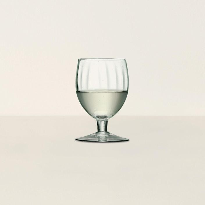 """What better way to say cheers to the new homeowners than with these wine glasses? $55, Goodee. <a href=""""https://www.goodeeworld.com/collections/kitchen/products/mia-wine-glass"""" rel=""""nofollow noopener"""" target=""""_blank"""" data-ylk=""""slk:Get it now!"""" class=""""link rapid-noclick-resp"""">Get it now!</a>"""