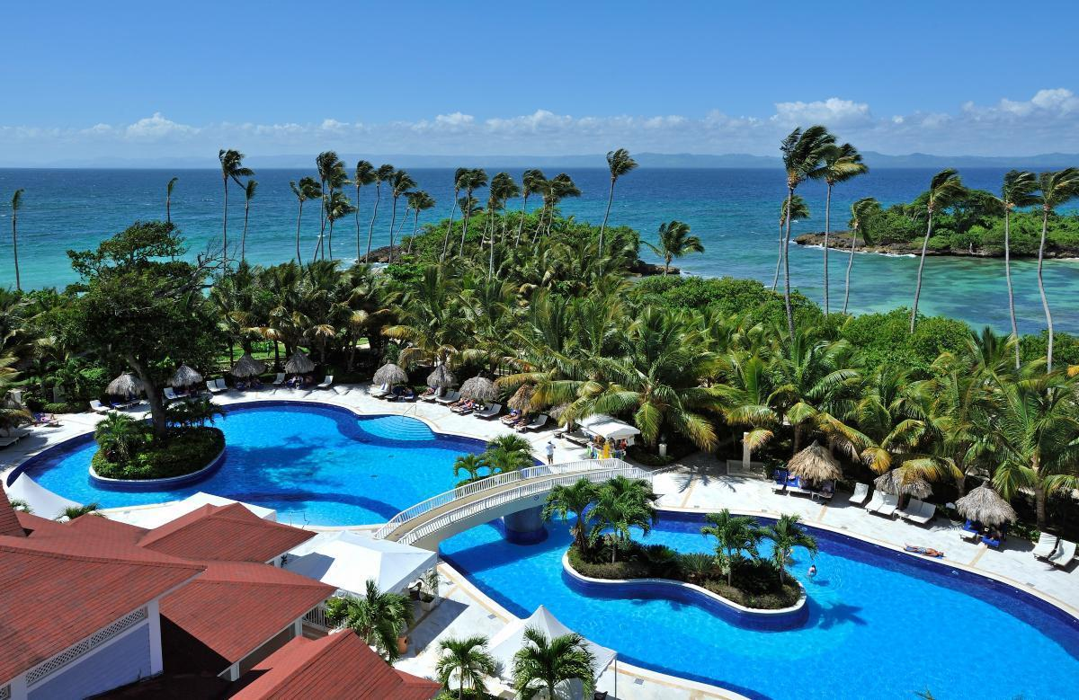 """<p>This 268-room Dominican resort boasts six restaurants, four bars, and two pools — and it's full of <a href=""""https://www.tripadvisor.com/TravelersChoice-Hotels-cAllInclusive-g1https://www.thedailymeal.com/travel/affordable-family-friendly-summer-vacation-trips-gallery?referrer=yahoo&category=beauty_food&include_utm=1&utm_medium=referral&utm_source=yahoo&utm_campaign=feed"""">fun for the whole family</a>. Towel and waiter service is available at both pools and on the resort's beach, and guests also get a free hour every day to go kayaking, paddle surfing or snorkeling, play tennis or hire a catamaran. Scuba diving lessons can be taken in one of the resort's pools, and aerobics and dance lessons are available as well. It was also named one of the top 25 all-inclusive resorts in the world in the 2019 TripAdvisor Traveler's Choice Awards, which also named it the top all-inclusive spot in the entire Caribbean.</p>"""