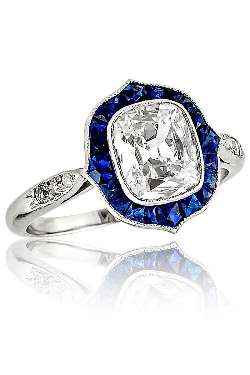 "<p><em><strong>Stephen Russ</strong><strong>ell</strong> Platinum Cushion Cut Diamond & Sapphire Ring, circa 1910, price upon request, <a href=""http://stephenrussell.com/"" rel=""nofollow noopener"" target=""_blank"" data-ylk=""slk:stephenrussell.com"" class=""link rapid-noclick-resp"">stephenrussell.com</a> </em><a class=""link rapid-noclick-resp"" href=""http://stephenrussell.com/"" rel=""nofollow noopener"" target=""_blank"" data-ylk=""slk:SHOP"">SHOP</a></p>"