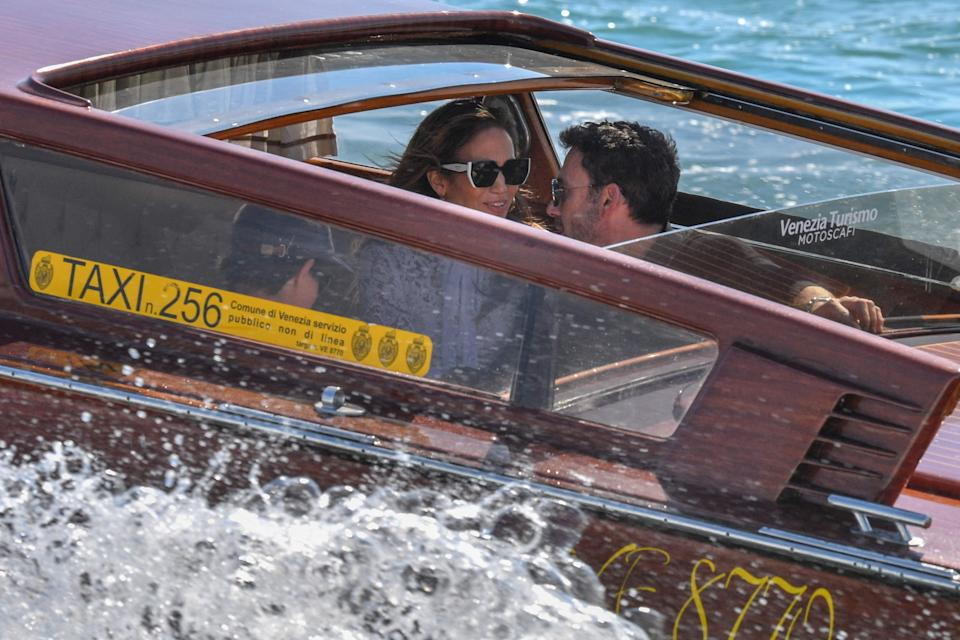 Ben Affleck and Jennifer Lopez travel across the Venice basin towards the Cipriani Hotel aboard a vaporetto taxi boat on September 9, 2021 after they arrived to attend the 78th Venice Film Festival in Venice.