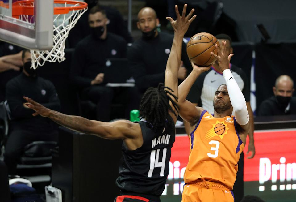 LOS ANGELES, CALIFORNIA - JUNE 30: Chris Paul #3 of the Phoenix Suns goes up for a shot against Terance Mann #14 of the LA Clippers during the first half in Game Six of the Western Conference Finals at Staples Center on June 30, 2021 in Los Angeles, California. NOTE TO USER: User expressly acknowledges and agrees that, by downloading and or using this photograph, User is consenting to the terms and conditions of the Getty Images License Agreement. (Photo by Harry How/Getty Images)