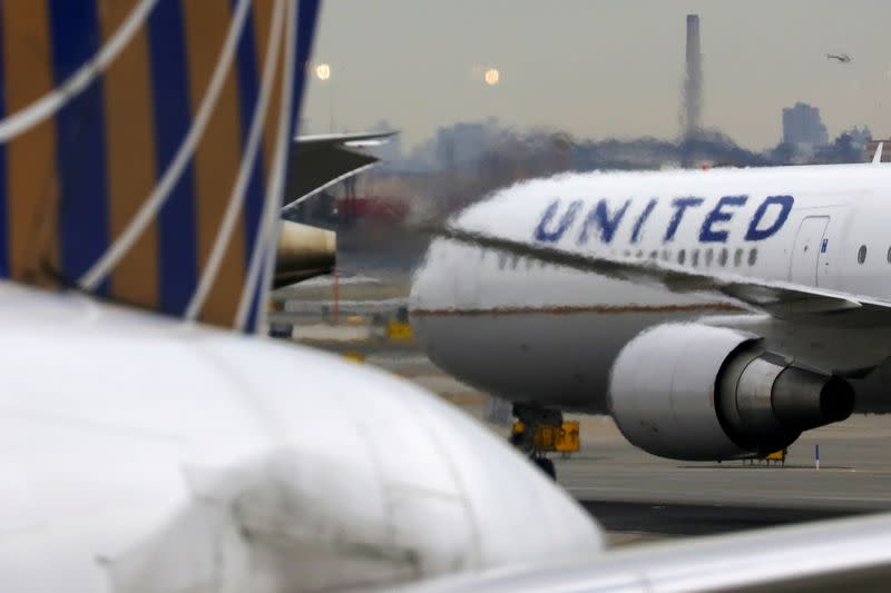 FILE PHOTO: FILE PHOTO: A United Airlines passenger jet taxis at Newark Liberty International Airport