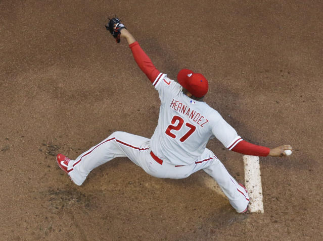 Philadelphia Phillies starting pitcher Roberto Hernandez throws during the first inning of a baseball game against the Milwaukee Brewers Wednesday, July 9, 2014, in Milwaukee. (AP Photo/Morry Gash)