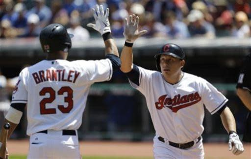Cleveland Indians' Asdrubal Cabrera, right, is congratulated by Michael Brantley after Cabrera hit a solo home run off Toronto Blue Jays starting pitcher R.A. Dickey in the first inning of a baseball game, Thursday, July 11, 2013, in Cleveland. (AP Photo/Tony Dejak)