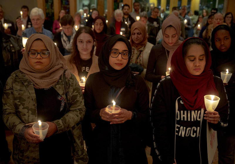 From left: Syeda Sabeera, Sumaiya Syed and Amina Choudhury stand with candles during a prayer service at St. James Episcopal Church on March 16 in Austin, Texas. The service was held in honor of those killed and injured in last Friday's mass shootings at two mosques in Christchurch, New Zealand. (Nick Wagner/Austin American-Statesman / ASSOCIATED PRESS)