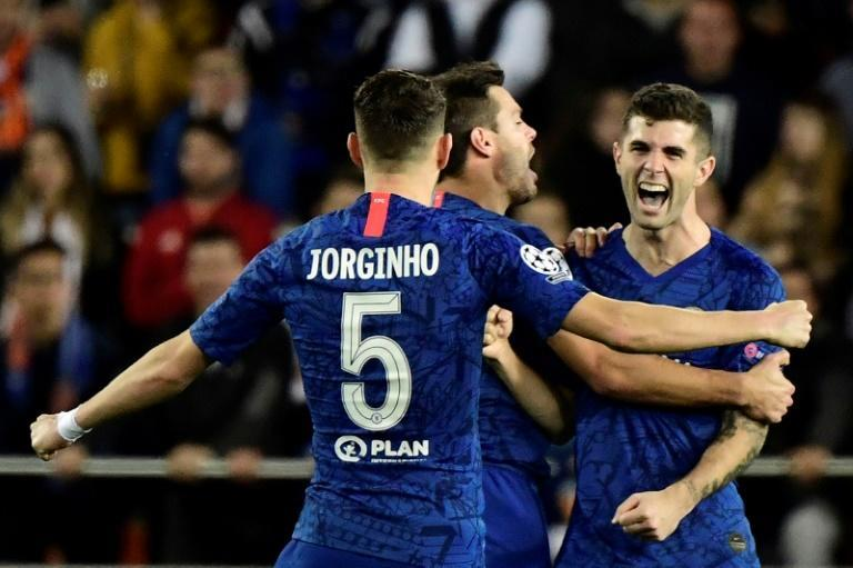 Christian Pulisic (right) celebrates Chelsea's second goal in a 2-2 draw at Valencia (AFP Photo/JAVIER SORIANO)