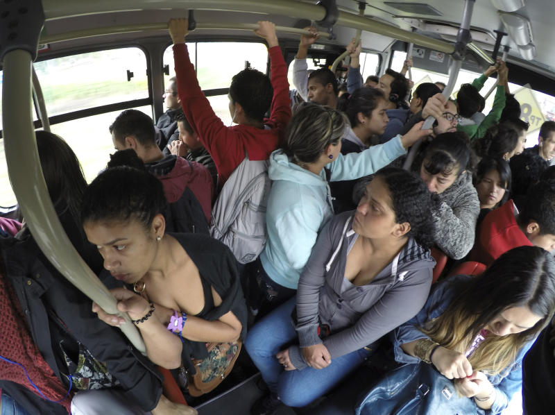 Passengers are seen on the Transmilenio system bus during rush hour in Bogota, Colombia. (John Vizcaino / Reuters)
