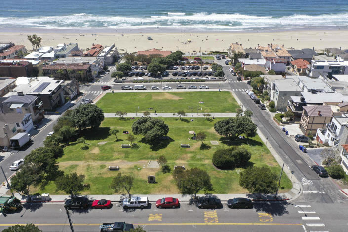 FILE - This April 8, 2021 file photo shows Bruce's Beach in Manhattan Beach, Calif. Los Angeles County leaders took initial steps Tuesday, April 20, 2021, toward returning prime beachfront property to descendants of a Black couple who built a resort for African Americans but were stripped of the land by local city officials a century ago. (Dean Musgrove/The Orange County Register via AP, File)