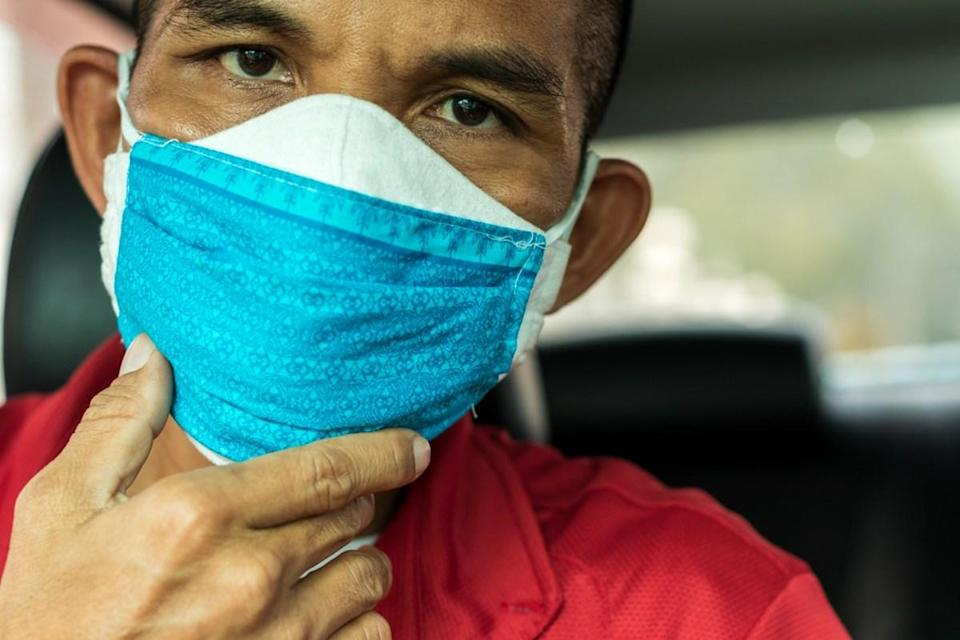 Male wearing two face masks.