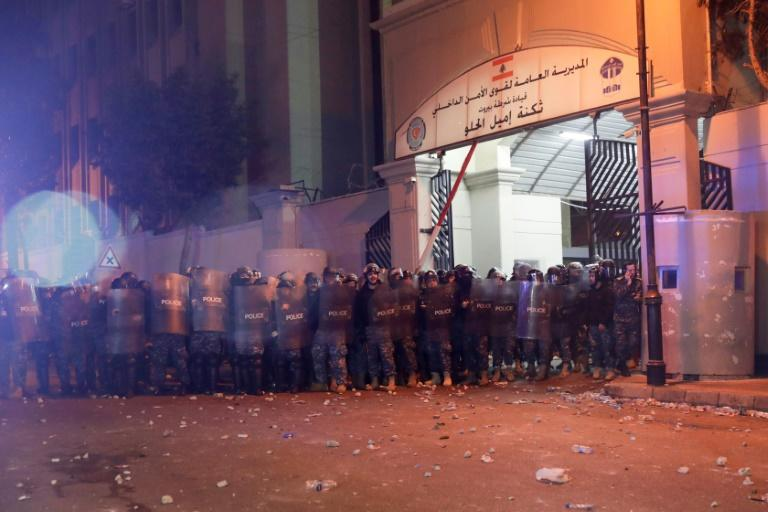 Lebanese riot police gather outside their barracks following a gathering to demand the release of detainees who were arrested overnight in Beirut on January 15 (AFP Photo/ANWAR AMRO)