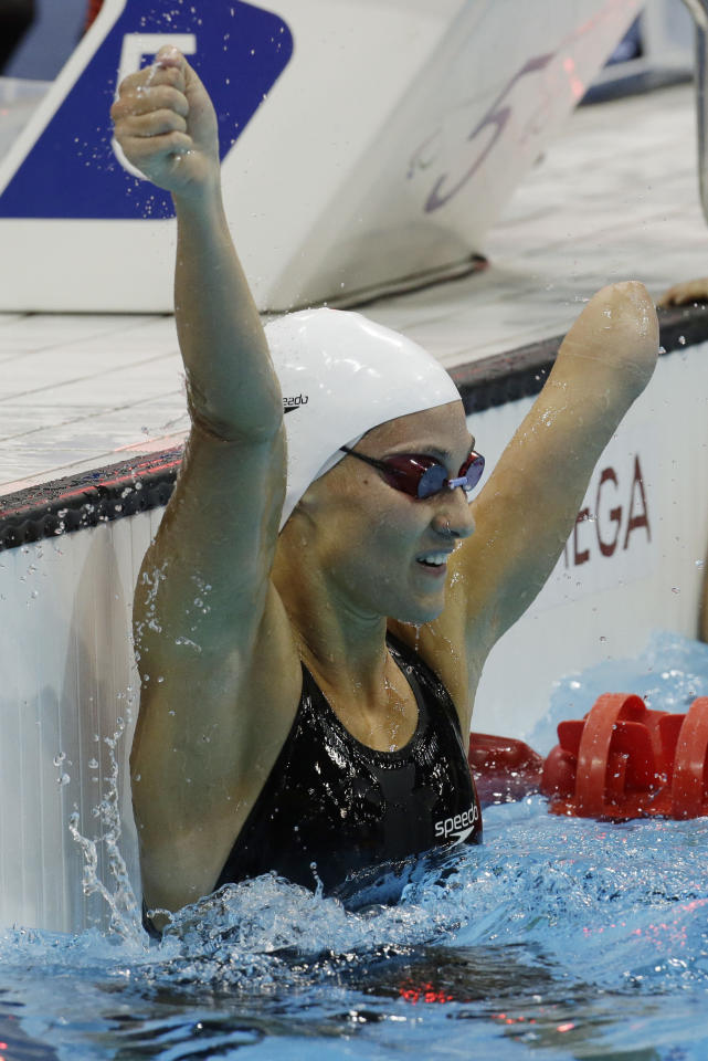 Spain's Sarai Gascon celebrates after finishing third and winning the bronze medal in the women's 100m freestyle S9 final at the 2012 Paralympics, Friday, Sept. 7, 2012, in London. (AP Photo/Lefteris Pitarakis)