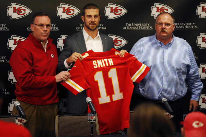 FILE - In this March 13, 2013 file photo, Kansas City Chiefs general manager John Dorsey, left, stands with head coach Andy Reid and newly signed quarterback Alex Smith following a news conference at the teams practice facility in Kansas City, Mo. The Chiefs were abysmal last season, going 2-14 yet having six players making the Pro Bowl. Now they have a quality quarterback in Alex Smith, a perennially successful coach, an aggressive new general manager, and the look of a team that could soar in the standings. (AP Photo/Orlin Wagner, File)