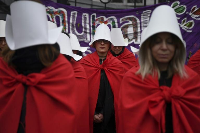 """Activists in favor of the legalization of abortion don costumes inspired by  Canadian author Margaret Atwood's feminist dystopian novel """"The Handmaid's Tale;"""" a sequel is to be published next year"""