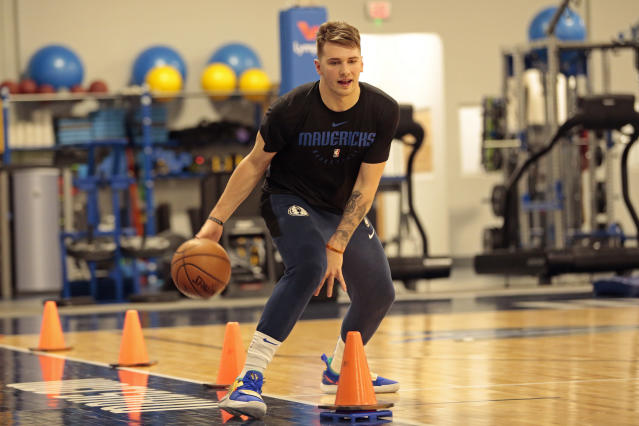 Luka Doncic works on his ball-handling skills during a recent Mavs practice. (Getty)