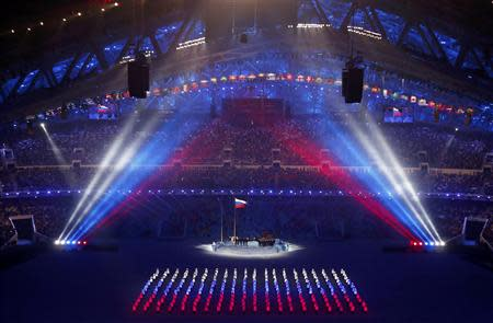 The Russian flag is being raised during the opening ceremony of the 2014 Sochi Winter Olympics, February 7, 2014. REUTERS/David Gray