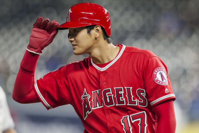 Shohei Ohtani tips his cap after making it safely to third base durning the game between the Kansas City Royals and the Los Angeles Angels on Friday. (Getty Images)