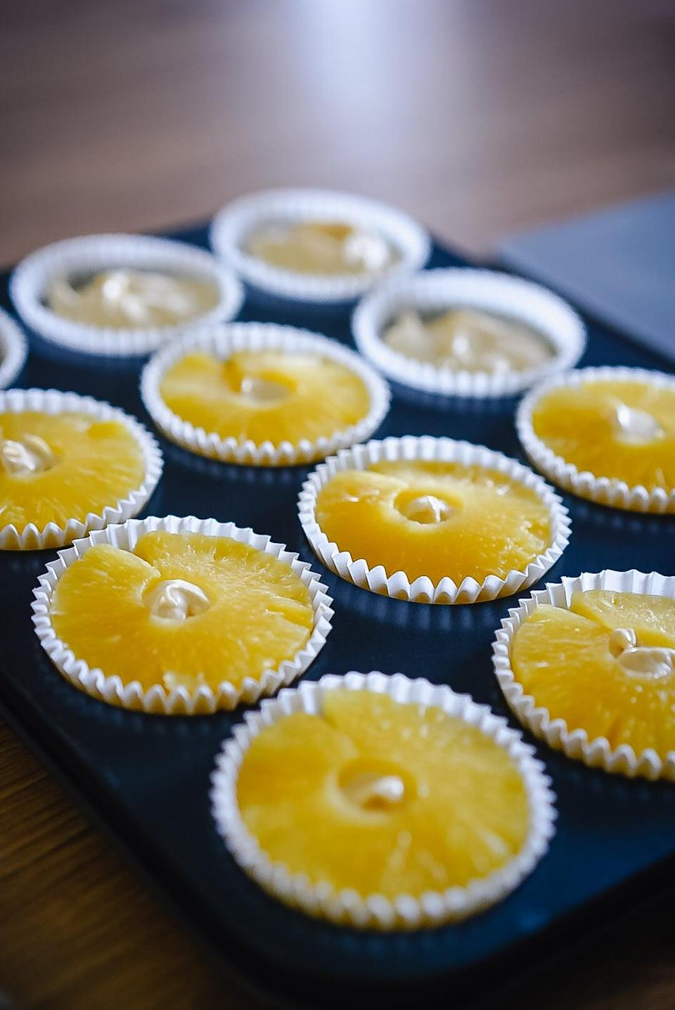 <p><strong>Method:</strong></p> <ol> <li>Preheat oven to 170 fan and line a 12-hole cupcake tin with paper cases.</li> <li>Cut a piece out of each pineapple ring so they fit into paper cases. </li> <li>Beat butter and sugar together until light and fluffy, then add eggs, flour, bicarb, and vanilla and mix well. Add enough milk to loosen mixture a little. </li> <li>Fill each paper case 3/4 full, then top with pineapple ring. Scatter a little Demerara sugar onto each cupcake and bake for 20-25 minutes or until skewer comes out clean.</li> <li>Place jam into piping bag and snip the end. Once cupcakes are cooled, poke a little hole into each cupcake with a skewer and pipe in the cherry jam.</li> <li>To make the buttercream, beat butter then add icing sugar until smooth and light. Add coconut extract and enough milk to loosen. </li> <li>Place buttercream into piping bag with a round nozzle and pipe a swirl on top. Roll cupcake into toasted coconut, then add a swirl to the top of each one. </li> <li>Place cherries into glitter pot and shake to remove the excess. Top each cupcake with a cherry!</li> </ol>