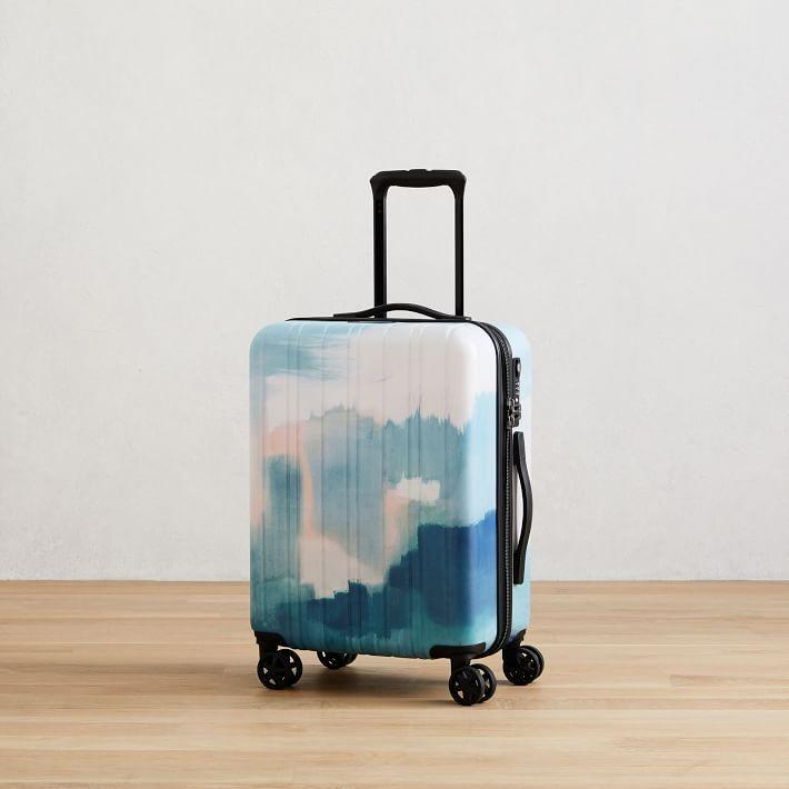 """<p>westelm.com</p><p><strong>$120.00</strong></p><p><a href=""""https://go.redirectingat.com?id=74968X1596630&url=https%3A%2F%2Fwww.westelm.com%2Fproducts%2Fwest-elm-rolling-luggage-print-20-d7039&sref=https%3A%2F%2Fwww.cosmopolitan.com%2Flifestyle%2Fg31699444%2Fgemini-gift-guide%2F"""" rel=""""nofollow noopener"""" target=""""_blank"""" data-ylk=""""slk:Shop Now"""" class=""""link rapid-noclick-resp"""">Shop Now</a></p><p>If you're going the useful gift route, a carry-on suitcase is perfect for travel-loving Gemini. Choose a trendy design or a lively print to ensure that your BFF is flying in style.</p>"""