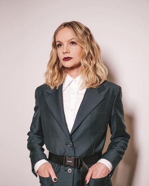 "<p>Mulligan wore a custom-made suit by Prada for the Awards ceremony.</p><p><a href=""https://www.instagram.com/p/COAL1xmjImm/"" rel=""nofollow noopener"" target=""_blank"" data-ylk=""slk:See the original post on Instagram"" class=""link rapid-noclick-resp"">See the original post on Instagram</a></p>"