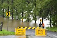 Rainfall records were forecast to continue tumbling in the coming days as the deluge spreads further north into Australia's Queensland state