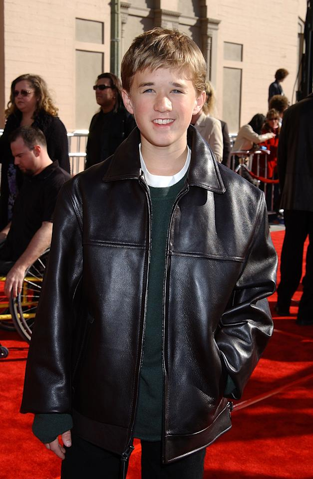 """<a href=""""https://people.com/celebrity/haley-joel-osment-reddit-ama-fun-facts-from-the-sixth-sense-stars-session/"""">In a 2014 Reddit AMA</a>, Osment — here in 2002 — said his childhood was (almost) as normal as could be.  """"My parents made a tremendous effort to have a home life, education, and community that preserved the privacy and freedom kids need,"""" he wrote. """"I went to a regular elementary school, high school, and went to university with only two work-related interruptions in those last four years."""""""