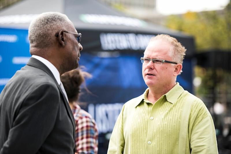 Artist and educator Robert Powell, left, talkswith Chris King, editorial director of the St. Louis American.