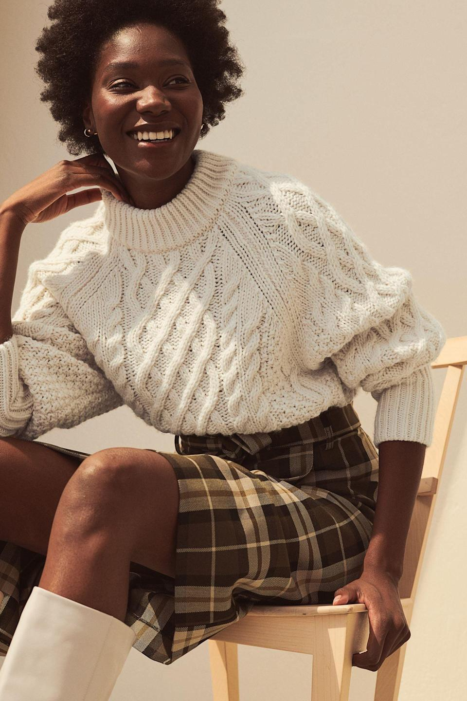 <p>Take a cue from the styling, and pair this <span>Cable-Knit Sweater</span> ($35) with a plaid skirt and over-the-knee boots.</p>