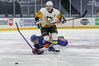 New York Islanders center Anders Lee (27) falls to the ice after colliding with Pittsburgh Penguins center Sidney Crosby (87) during the second period of an NHL hockey game, Sunday, Feb. 28, 2021, in Uniondale, N.Y. (AP Photo/Kathy Willens)