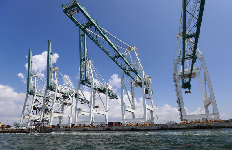 FILE - In this July 24, 2019 photo, file large cranes to unload container ships are shown at PortMiami in Miami. The Trump administration is seeking to tax up to $25 billion in European Union imports in a rift over the EU's subsidies to aircraft giant Airbus. It's also threatening to impose tariffs to punish France for a digital services tax that targets U.S. internet giants Google, Amazon and Facebook. (AP Photo/Wilfredo Lee, File)