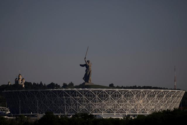 A general view shows Volgograd Arena stadium and the statue of Mother Homeland at the Mamayev Kurgan World War Two memorial complex in Volgograd, Russia June 20, 2018. REUTERS/Ueslei Marcelino