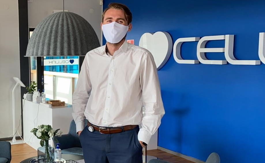 Gusten Danielsson, CFO of Cellink, wears a bluetooth transmitter on his belt that warns him if he gets too close to other employees. (Cellink)