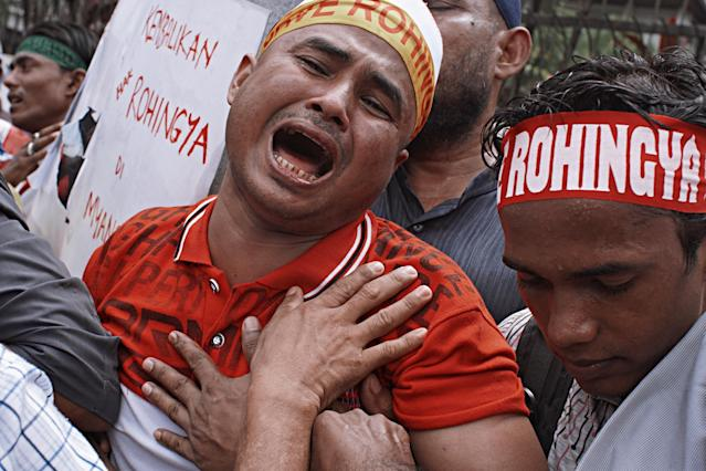 <p>A man reacts during a protest against the conflict in Rakhine state, Myanmar on Sept. 8, 2017 in Kuala Lumpur, Malaysia. (Photo: Rahman Roslan/Getty Images) </p>
