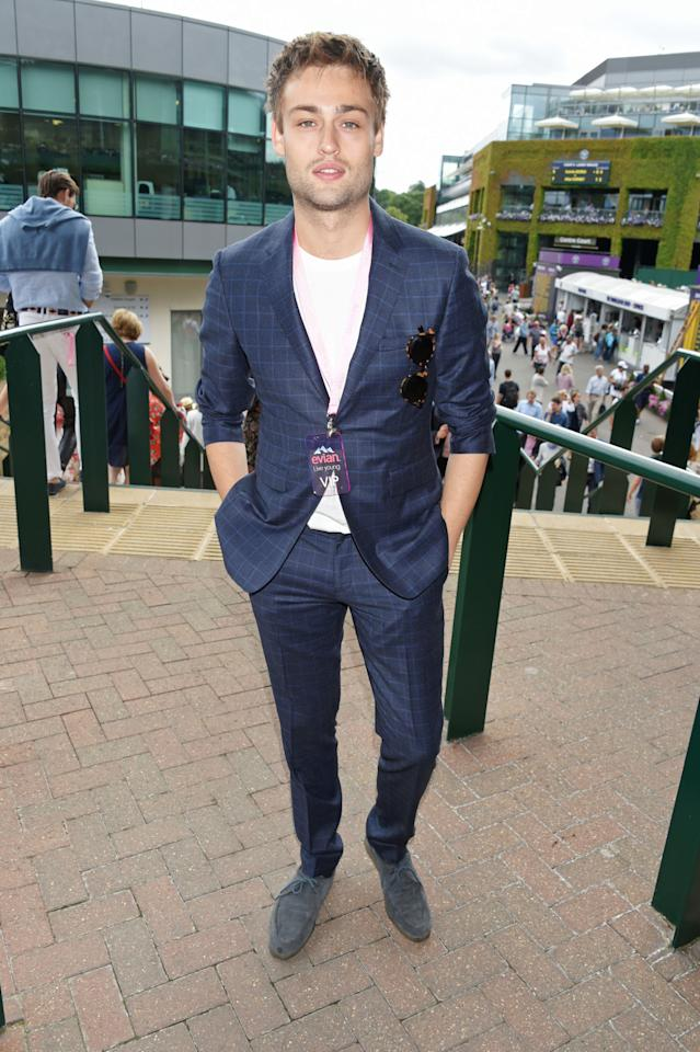 <p>While we'd typically advise against rolling up the sleeves on your suit jacket, Douglas Booth gets something of a pass here due to the summery way he's styled it and the fact that he's slim enough to avoid too much bunching. </p>