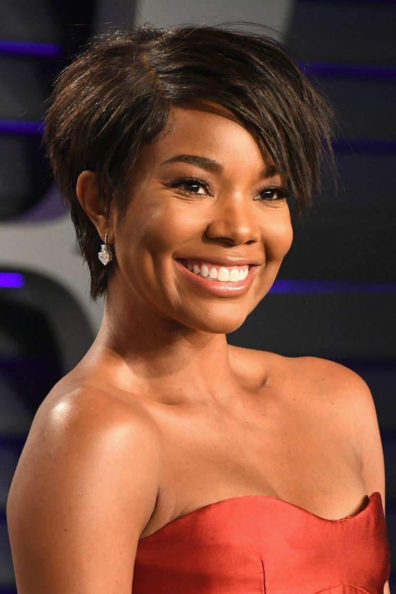 <p>Take inspiration from actress Gabrielle Union and give your layered pixie a deep side part for a more structured look. </p>