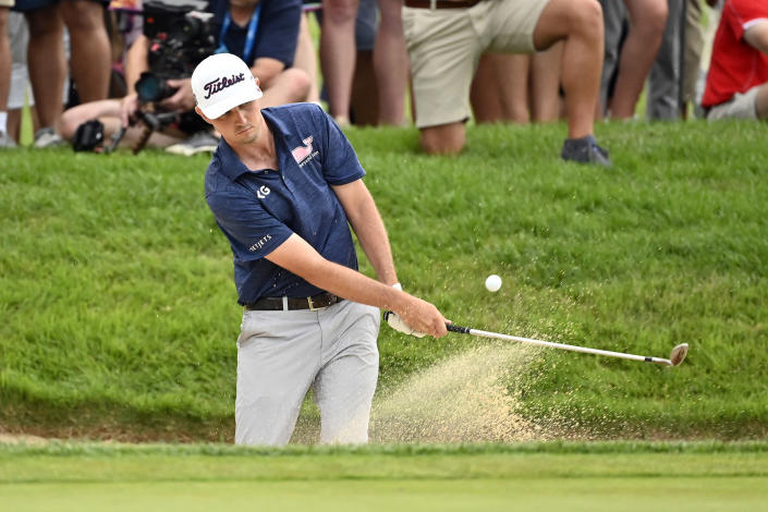 J.T. Poston hits out of a bunker during the fourth playoff hole at the Barbasol Championship golf tournament at Keene Trace in Nicholasville, Ky., Sunday, July 18, 2021. (AP Photo/Timothy D. Easley)