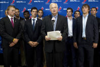 FILE - In this Aug. 14, 2012, file photo, Donald Fehr, center, executive director of the National Hockey League Players' Association, stands with NHL hockey players including Tampa Bay Lightning's Steven Stamkos, left, Pittsburgh Penguins' Sidney Crosby, second from left, and Washington Capitals' Alex Ovechkin, right, as they speak with reporters following collective bargaining talks in Toronto. The NHLPA announces its decision whether to terminate the current collective bargaining agreement and set the clock ticking toward another potential work stoppage in 2020. (AP Photo/The Canadian Press, Chris Young, File)
