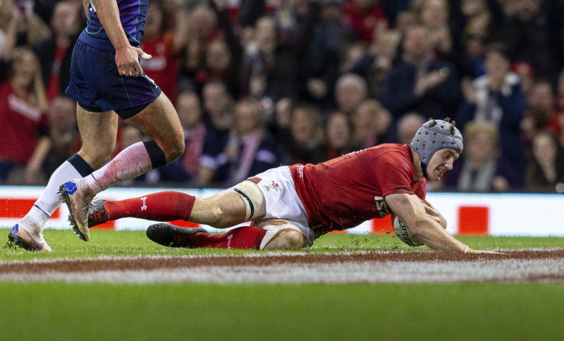 Wales' Jonathan Davies scores their second try against Scotland during the rugby union international match at The Principality Stadium, Cardiff, Wales, Saturday Nov. 3, 2018. (David Davies/PA via AP)