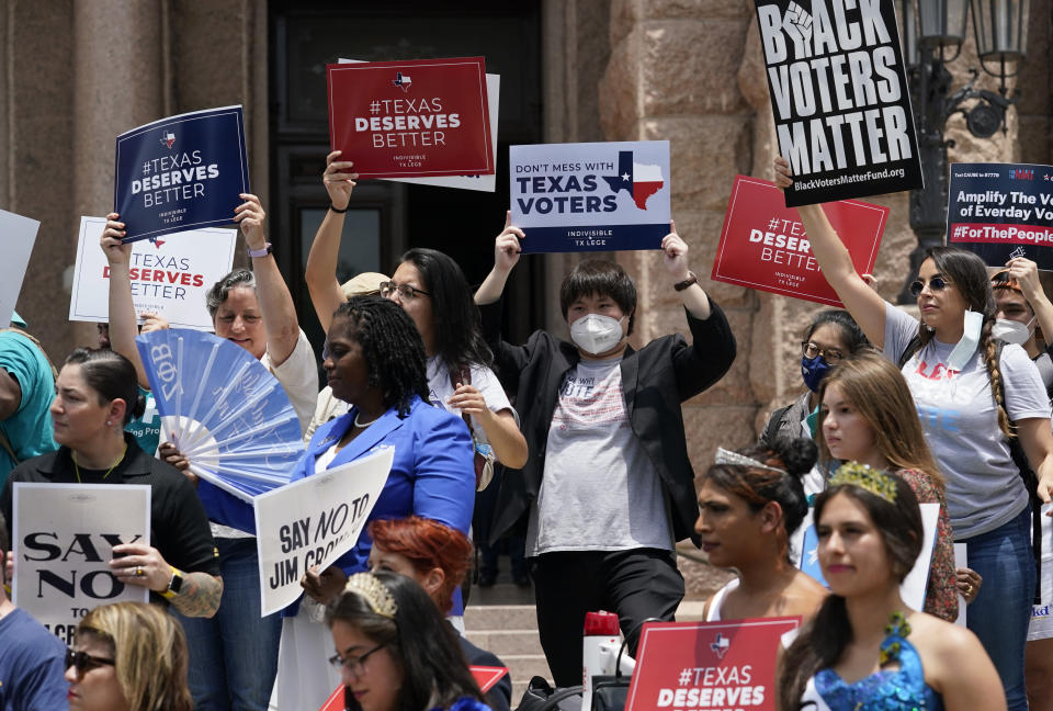 Demonstrators join a rally to protest proposed voting bills on the steps of the Texas Capitol, Tuesday, July 13, 2021, in Austin, Texas. Texas Democrats left the state to block sweeping new election laws, while Republican Gov. Greg Abbott threatened them with arrest the moment they return. (AP Photo/Eric Gay)
