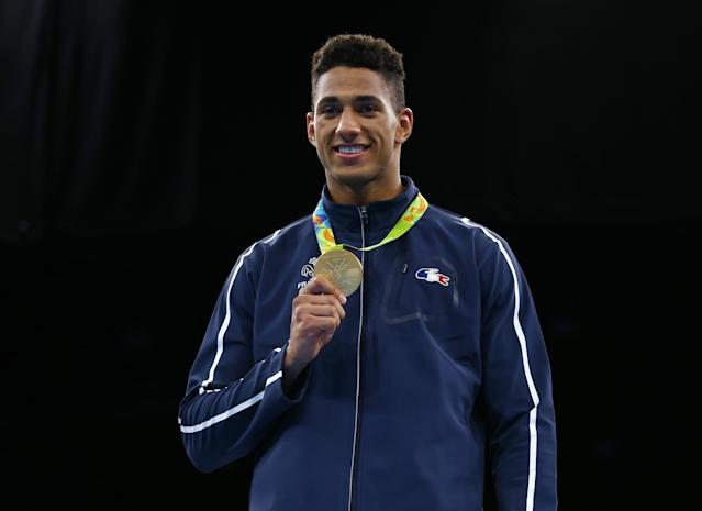 2016 Rio Olympics - Boxing - Victory Ceremony - Men's Super Heavy (+91kg) Victory Ceremony - Riocentro - Pavilion 6 - Rio de Janeiro, Brazil - 21/08/2016. Gold medallist Tony Yoka (FRA) of France poses with his medal. REUTERS/Peter Cziborra FOR EDITORIAL USE ONLY. NOT FOR SALE FOR MARKETING OR ADVERTISING CAMPAIGNS.