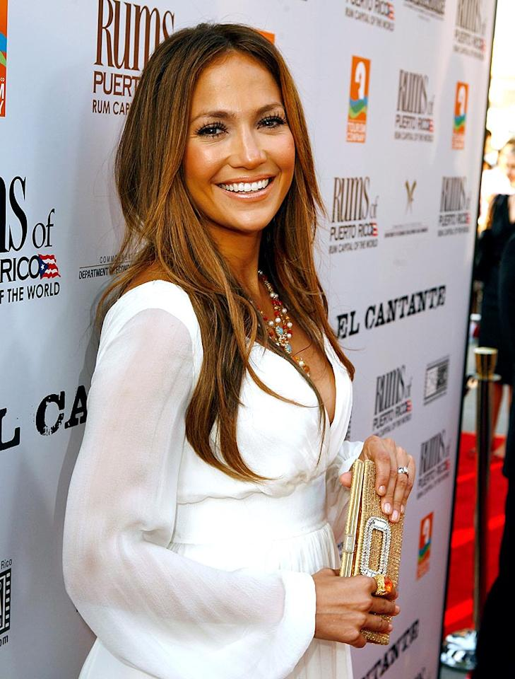 """Even Jennifer Lopez, the queen of bronzer, overdoses on her signature J.Lo glow from time to time. Her gauzy white gown just made it all the more obvious. Jeff Vespa/<a href=""""http://www.wireimage.com"""" target=""""new"""">WireImage.com</a> - July 31, 2007"""