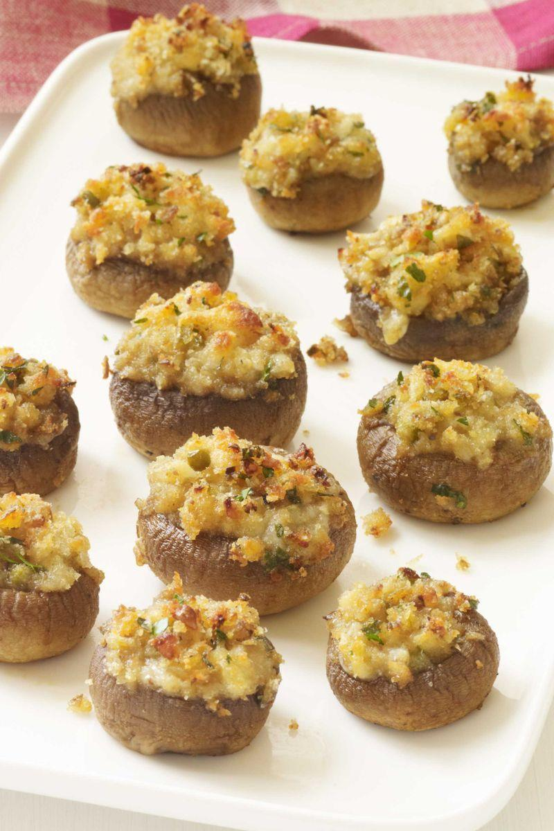"<p>These stuffed mushrooms pack big flavors into a tiny package.</p><p><a href=""https://www.womansday.com/food-recipes/food-drinks/recipes/a11418/stuffed-mushrooms-recipe-wdy1113/"" rel=""nofollow noopener"" target=""_blank"" data-ylk=""slk:Get the Stuffed Mushrooms recipe."" class=""link rapid-noclick-resp""><em>Get the Stuffed Mushrooms recipe.</em></a></p>"