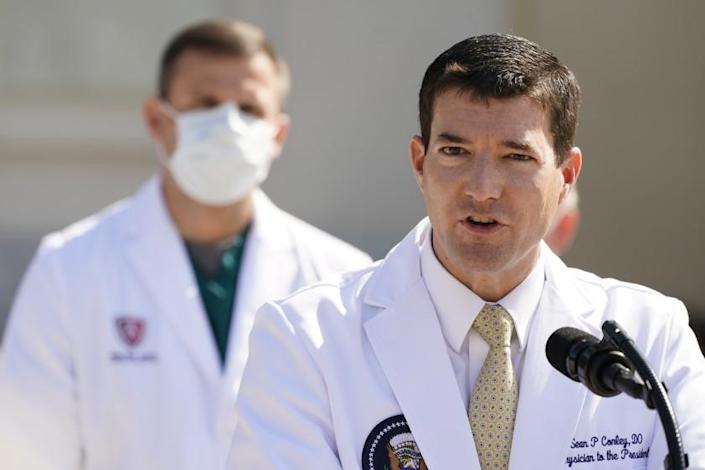 """Dr. Sean Conley, White House physician, briefs reporters at Walter Reed National Military Medical Center in Bethesda, Md., on Sunday. <span class=""""copyright"""">(Jacquelyn Martin / Associated Press )</span>"""