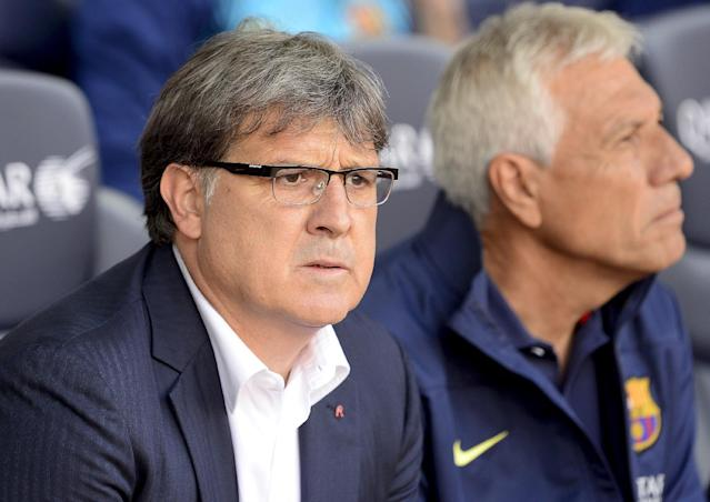 "Barcelona's Argentinian coach Gerardo ""Tata"" Martino looks on during the Spanish league football match FC Barcelona vs Club Atletico de Madrid at the Camp Nou stadium in Barcelona on May 17, 2014 (AFP Photo/Josep Lago)"