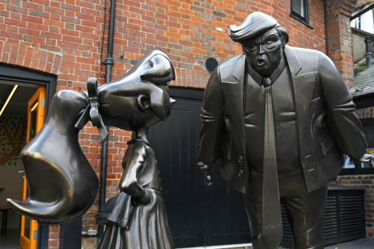 A sculpture of Roald Dahl character Matilda is seen next to one of US President Donald Trump at the newly renovated Roald Dahl Museum
