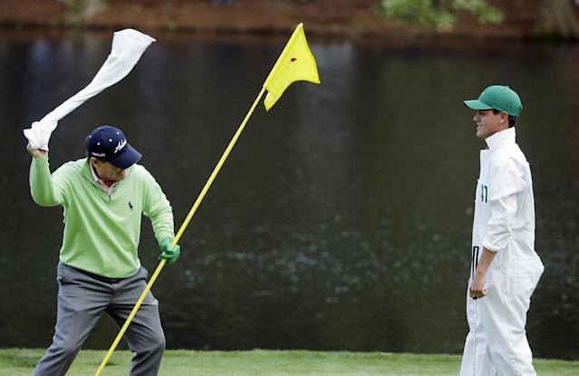 Tom Watson whips his towel a Jarrod Jordan after Jordan putted on the ninth hole during the par three competition at the Masters golf tournament Wednesday, April 9, 2014, in Augusta, Ga. (AP Photo/Chris Carlson)