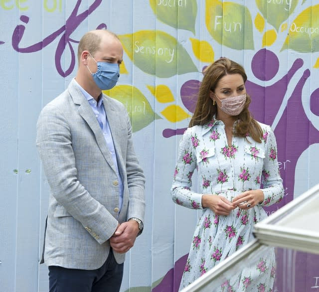 William and Kate wore masks during their visit to the care home. Jonathan Buckmaster/Daily Express
