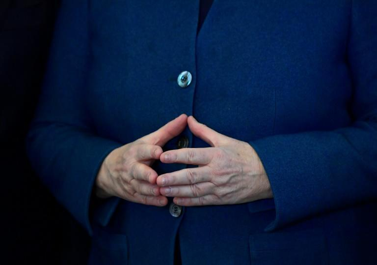 The gesture has been likened to a bridge, a protective roof, and even a sign made between Illuminati members (AFP/Tobias SCHWARZ)