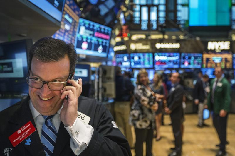A trader works on the floor of the New York Stock Exchange shortly before the end of the day's trading in New York